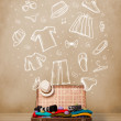 Traveler luggage with hand drawn clothes and icons — Stock Photo #43275803