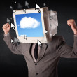 Business man with a monitor on his head, cloud system and pointe — Stock Photo