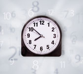 Modern clock with numbers comming out — Stock Photo