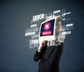 Business man with pc monitor on his head and error messages on t — Stock Photo