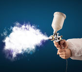 Painter with airbrush gun and white magical smoke  — Foto Stock
