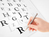 Hand writing various letters on white plain paper — ストック写真