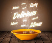 Soup with delicious and tasty glowing writings — Stock Photo