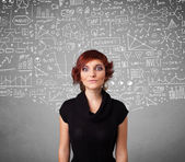 Young pretty lady with hand drawn calculations and icons — Stok fotoğraf