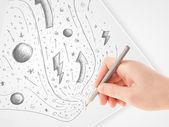手を紙の上の抽象的なスケッチや落書きの描画 — ストック写真