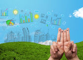 Happy smiley fingers looking at hand drawn urban city landscape — Stock Photo