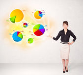Business woman with colorful graphs and charts — Photo