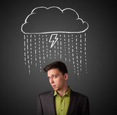 Businessman with thundercloud above his head — Photo