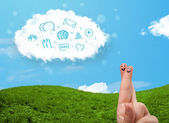 Happy smiley fingers looking at cloud with blue social icons and — Stock Photo