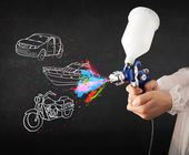 Man with airbrush spray paint with car, boat and motorcycle draw — Photo