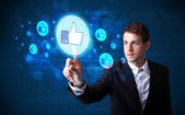 Handsome person pressing thumbs up button on modern social netwo — Stock Photo