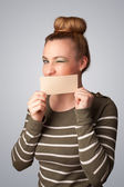 Cute girl holding white card at front of her lips with copy spac — Stock Photo