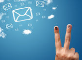 Happy smiley fingers looking at mail icons made out of clouds — Foto de Stock