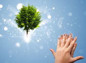 Happy finger smileys with green magical glowing tree — Stock Photo