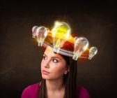Woman with light bulbs circleing around her head — Foto de Stock