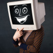Girl with a monitor head and a cheerful cartoon face — Stock Photo #45894195
