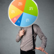 Businessman holding a pie chart — Stock Photo #45894207