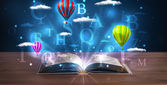 Open book with glowing fantasy abstract clouds and balloons — 图库照片