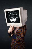 Girl with a monitor head and a cheerful cartoon face — Stock Photo