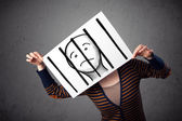 Woman holding a paper with a prisoner behind the bars on it in f — Stock Photo
