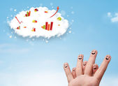 Happy finger smiley with graph cloud icons in the sky — Stock Photo