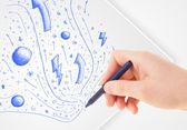 Dibujo abstractos dibujos y garabatos en el papel de la mano — Foto de Stock