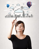 Pretty woman sketching cityscape with colorful balloons — Stock Photo