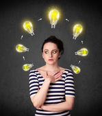 Young woman thinking with lightbulb circulation around her head — Stock Photo