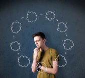 Young man thinking with cloud circulation around his head — Stock Photo