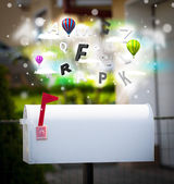 Post box with colorful letters — Stock fotografie