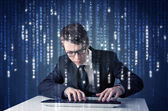 Hacker decoding information from futuristic network technology — Stock Photo