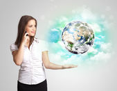 Young woman with earth and cloud concept — Stock Photo