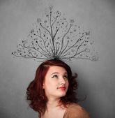 Młoda kobieta z splątanych linii pochodzących z jej głowy — Zdjęcie stockowe