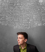 Thoughtful businessman with charts above his head — Stock Photo
