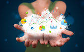 Young woman presenting cloud with charts and graph icons and sym — Stock Photo