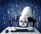 Hacker in body mask decoding information from futuristic network — Stock Photo