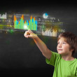 Young boy touching colorful charts and diagrams — Stock Photo #46794621