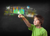 Young boy touching colorful charts and diagrams — Stock Photo