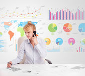 Business woman with colorful charts  — Stock Photo