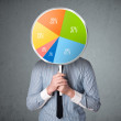 Businessman holding a pie chart — Stock Photo #46991035