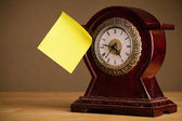 Empty post-it note sticked on alarm clock — Stock Photo