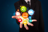 Young businessman presenting colorful technology icons and symbo — Stock Photo