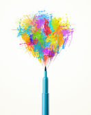 Felt pen close-up with colored paint splashes — Stock Photo