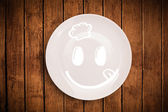 Happy smiley cartoon face on colorful dish plate — Стоковое фото