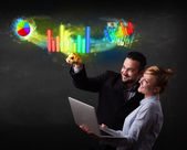 Young business couple touching colorful modern graph system conc — Photo