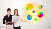 Business woman with colorful graphs and charts — Stockfoto