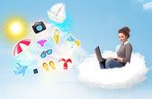 Joven empresario sentado en la nube con el ordenador portátil — Foto de Stock