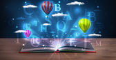 Open book with glowing fantasy abstract clouds and balloons — ストック写真