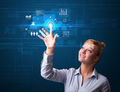 Young business woman touching future web technology buttons and  — Photo