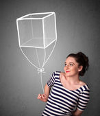 Woman holding a cube balloon — Stock Photo